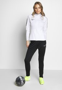 Nike Performance - DRY ACADEMY SUIT - Tracksuit - white/black - 1