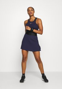 Nike Performance - MARIA DRESS - Sports dress - blackened blue/black/stone mauve - 1