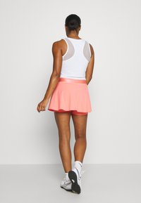 Nike Performance - FLOUNCY SKIRT - Sports skirt - sunblush/white - 2