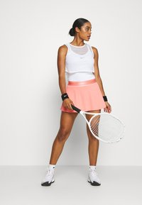 Nike Performance - FLOUNCY SKIRT - Sports skirt - sunblush/white - 1