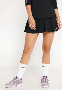 Nike Performance - FLOUNCY SKIRT - Sports skirt - black/white - 0