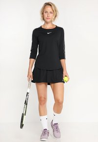 Nike Performance - FLOUNCY SKIRT - Sports skirt - black/white - 1