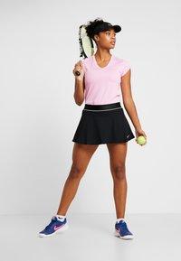 Nike Performance - FLOUNCY SKIRT - Sports skirt - black/white - 1