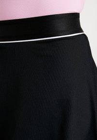 Nike Performance - FLOUNCY SKIRT - Sports skirt - black/white - 5