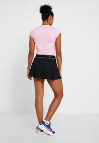 Nike Performance - FLOUNCY SKIRT - Sports skirt - black/white - 2
