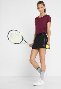 Nike Performance - DRY SKIRT - Falda de deporte - black/white - 1