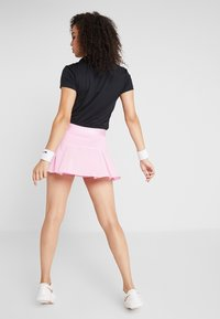 Nike Performance - VICTORY SKIRT - Sports skirt - pink rise/white - 2