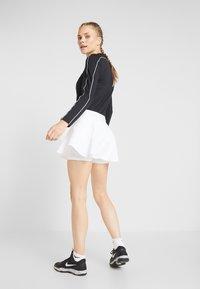 Nike Performance - FLOUNCY SKIRT - Sports skirt - white/black - 2