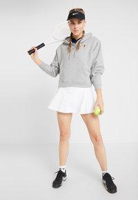 Nike Performance - FLOUNCY SKIRT - Sports skirt - white/black - 1