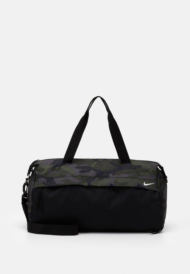 RADIATE - Sports bag - black/white