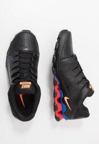 Nike Performance - REAX 8 TR - Obuwie treningowe - black/total orange/university red - 1