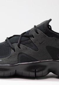 Nike Performance - FREE RN 5.0 - Minimalist running shoes - black - 5