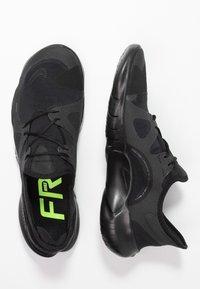 Nike Performance - FREE RN 5.0 - Minimalist running shoes - black - 1