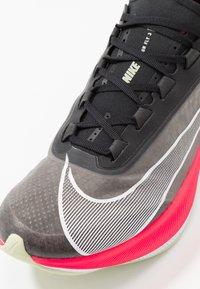 Nike Performance - ZOOM FLY 3 - Neutral running shoes - black/white/laser crimson/olive aura - 5