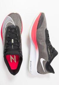 Nike Performance - ZOOM FLY 3 - Neutral running shoes - black/white/laser crimson/olive aura - 1
