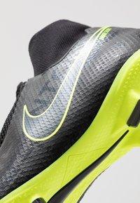 Nike Performance - PHANTOM VSN PRO DF FG - Voetbalschoenen met kunststof noppen - black/volt - 5