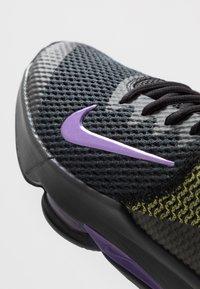 Nike Performance - LEBRON WITNESS IV - Obuwie do koszykówki - black/voltage purple/opti yellow/white - 5
