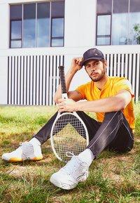 Nike Performance - COURT LITE 2 PRIME QUICK STRIKE - Multicourt tennis shoes - white/amber rise - 7