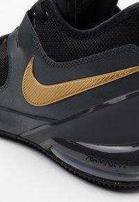 Nike Performance - AIR MAX IMPACT - Basketball shoes - black/metallic gold/dark smoke grey - 5