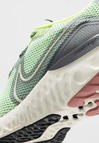 Nike Performance - RENEW  - Juoksukenkä/neutraalit - barely volt/pale ivory/smoke grey/canyon pink/black/volt - 5