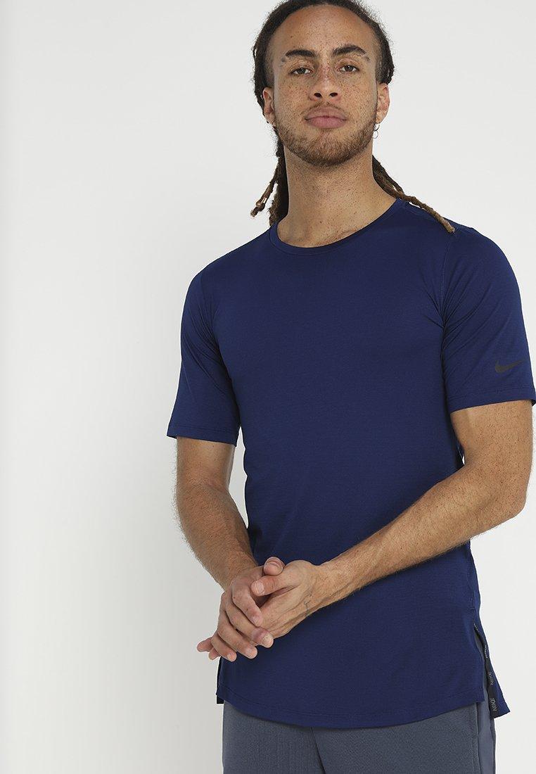 Nike Performance - UTILITY - Basic T-shirt - blue void/black