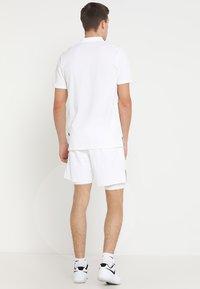 Nike Performance - HERITAGE - Polo - white - 2
