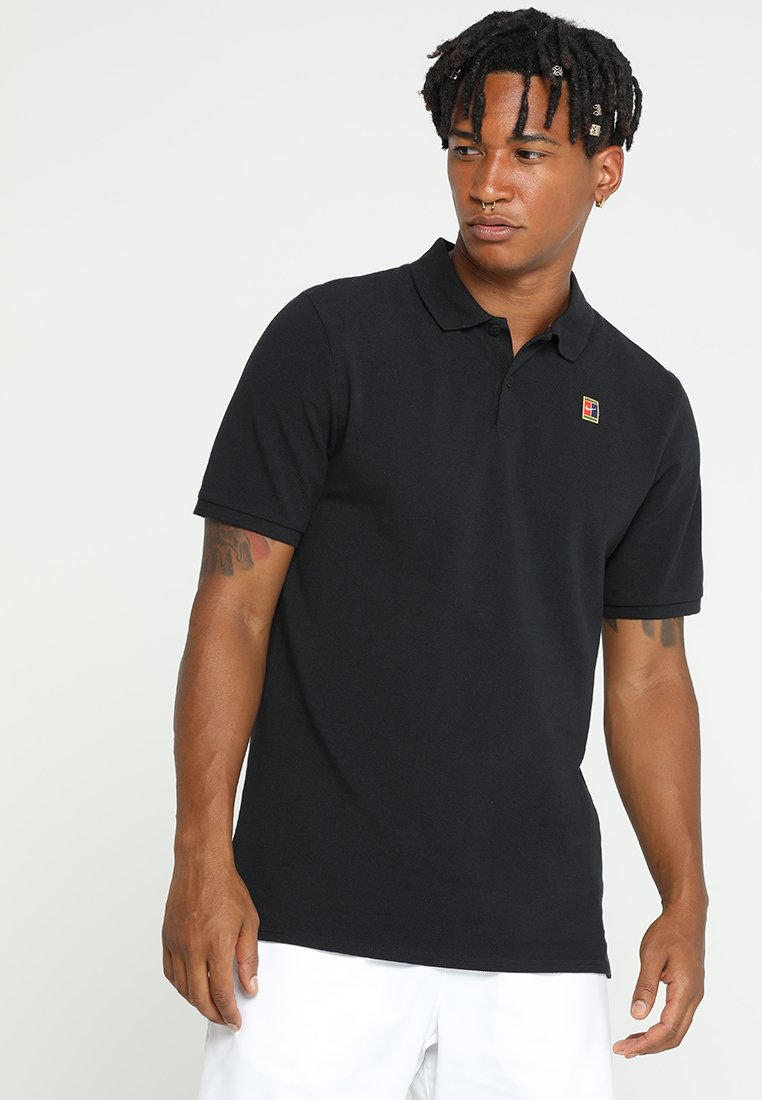 Nike Performance - HERITAGE - Polo shirt - black/white