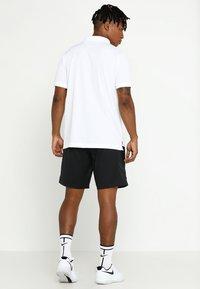Nike Performance - DRY TEAM - Sports shirt - white/black - 2