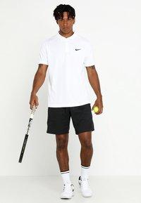 Nike Performance - DRY TEAM - Sports shirt - white/black - 1