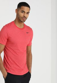 Nike Performance - DRY TEE CREW SOLID - Basic T-shirt - light university red heather/black - 0