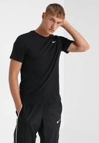 Nike Performance - DRY TEE CREW SOLID - T-shirts - black/white - 0