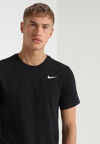 Nike Performance - DRY TEE CREW SOLID - T-shirts - black/white - 3