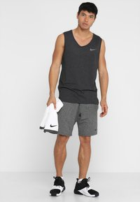 Nike Performance - TANK HYPERDRY - Sportshirt - black heather/metallic hematite - 1