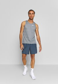Nike Performance - DRY MILER TANK - Sports shirt - smoke grey/reflective silver - 1