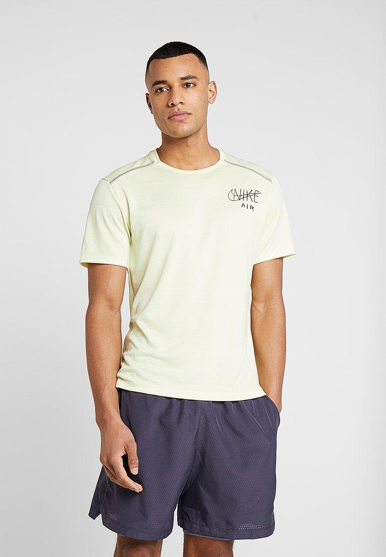 Nike Performance - DRY MILER - Camiseta estampada - luminous green/black/silver