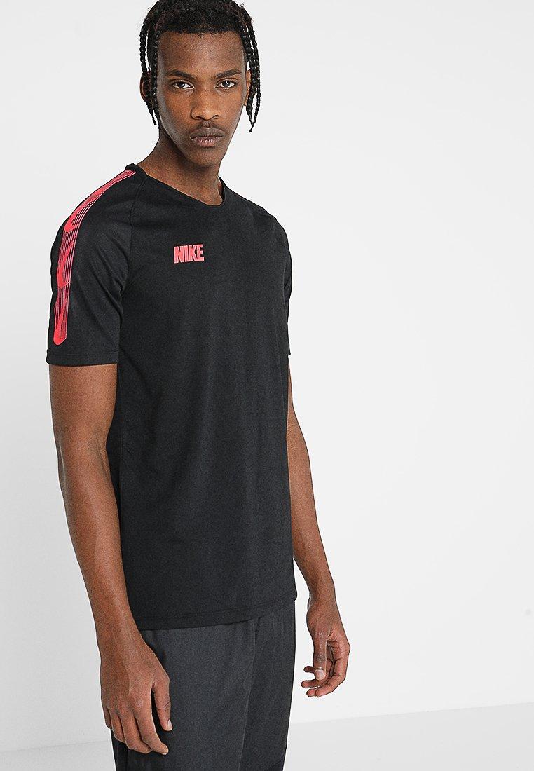 Nike Performance - T-shirt print - black/ember glow
