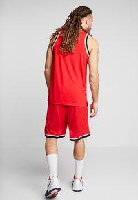 Nike Performance - CLASSIC - Träningsshorts - university red/black - 2