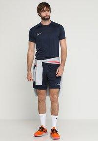 Nike Performance - DRY ACADEMY - T-shirts print - obsidian/white - 1