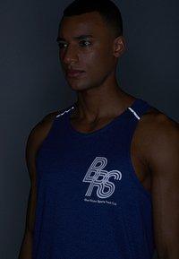 Nike Performance - RISE TANK - Sports shirt - blue void/pure - 4