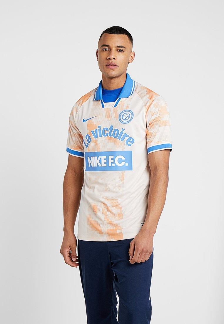 Nike Performance - T-shirt print - guava ice/white/pacific blue