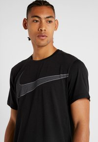 Nike Performance - DRY  - T-shirt imprimé - black/white - 4