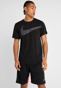 Nike Performance - DRY  - T-shirt imprimé - black/white - 0