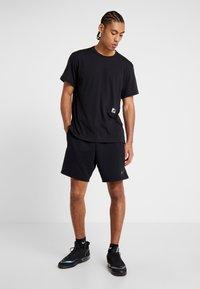 Nike Performance - DRY - Print T-shirt - black/habanero red - 1