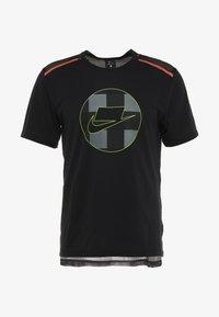 Nike Performance - WILD RUN - Camiseta estampada - black - 5