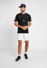 Nike Performance - PSG SS LOGO TEE - T-shirt print - black - 1