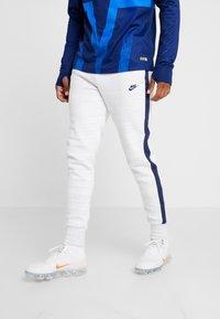 Nike Performance - PARIS ST GERMAIN PANT  - Tracksuit bottoms - white/wolf grey/university red/midnight navy - 0