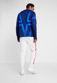 Nike Performance - PARIS ST GERMAIN PANT  - Tracksuit bottoms - white/wolf grey/university red/midnight navy - 2