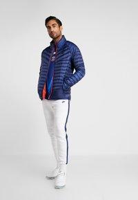 Nike Performance - PARIS ST GERMAIN PANT  - Tracksuit bottoms - white/wolf grey/university red/midnight navy - 1