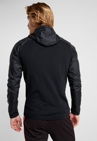 Nike Performance - DRY WINTERIZED - Long sleeved top - black/reflective silver - 2