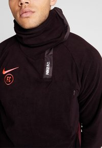 Nike Performance - Fleece jumper - burgundy ash/night maroon/racer pink - 8
